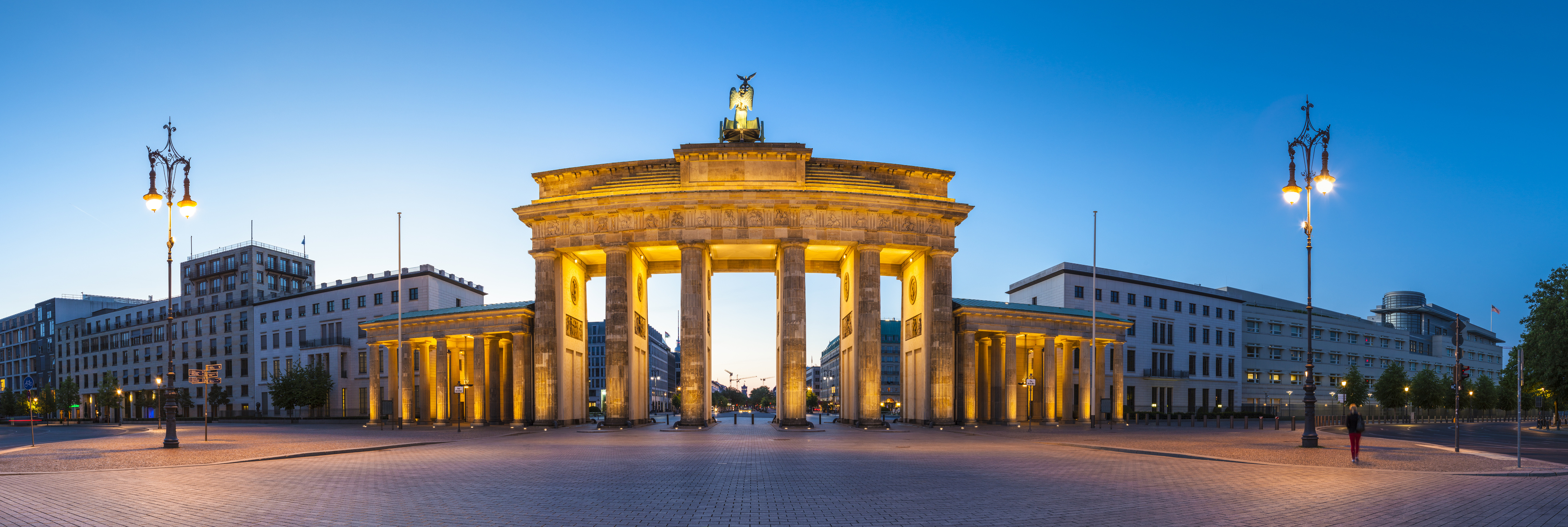 Pretty night time illuminations of the Brandenburg Gate (1788) inspired by Greek architecture, built as a symbol of peace and